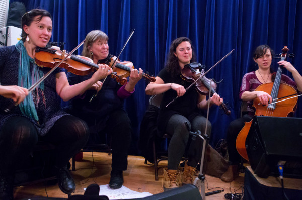 Molly Gawler (from left), Ellen Gawler, Edith Gawler, and Elsie Gawler perform with their family, the Gawler Family Band, during the Belfast contra dance at American Legion Post No. 43 on Friday. The Gawler family are a &quotfun-loving, folk-singing, fiddle-playing family&quot that are truly an only-in-Maine music group. They are committed to farming and old-time activities such as contra dancing and music.