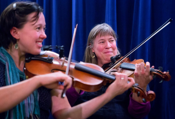 Molly Gawler (left), plays the fiddle with her mother, Ellen Gawler, with their family, the Gawler Family Band, during the Belfast contra dance at American Legion Post No. 43 on Friday. The Gawler family are a &quotfun-loving, folk-singing, fiddle-playing family&quot that are truly an only-in-Maine music group. They are committed to farming and old-time activities such as contra dancing and music.