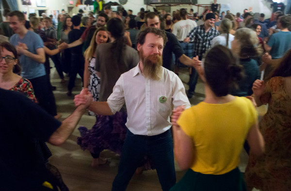 Members of the community dance while listening to the Gawler Family Band during the Belfast contra dance at American Legion Post No. 43 on Friday. The Gawler family are a &quotfun-loving, folk-singing, fiddle-playing family&quot that are truly an only-in-Maine music group. They are committed to farming and old-time activities such as contra dancing and music.