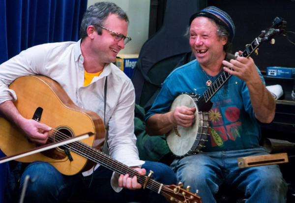 Bennett Konesni (left), and John Gawler laugh with each other while playing with their family, the Gawler Family Band, during the Belfast contra dance at American Legion Post No. 43 on Friday. The Gawler family are a &quotfun-loving, folk-singing, fiddle-playing family&quot that are truly an only-in-Maine music group. They are committed to farming and old-time activities such as contra dancing and music.