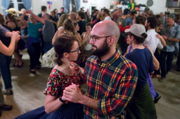 Members of the community dance while listening to the Gawler Family Band during the Belfast contra dance at American Legion Post No. 43 in Belfast Friday. The Gawler family are a &quotfun-loving, folk-singing, fiddle-playing family&quot that are truly an only-in-Maine music group. They are committed to farming and old-time activities such as contra dancing and music.