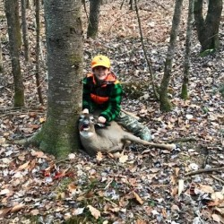 Brycen Waugh, 8, of Mexico, Maine, shows off the deer he shot while hunting in 2016. Waugh completed Maine's big game grand slam, taking a moose, bear, turkey and deer in the same calendar year. Maine eliminated its minimum age for hunting -- previously set at 10 years old -- before the 2016 hunting seasons.