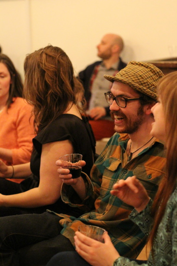 Audience members react during a reading by poet Jennifer Moxley, part of the series of events hosted by the Norumbega Collective in Bangor.