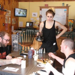Olivia Tasker pours coffee for R.J. Soucie, left, and Nick McCrfisson, right, at Dee's Route 202 Diner in Lebanon Tuesday morning. Owner Stephanie Harding said Maine's new minimum wage laws, approved by voters in a referendum Nov. 8, has meant she's had to lay off one employee, cut the hours of two others and reduce the diner's evening schedule from three nights to one for the winter months. The diner is open seven days a week for breakfast and lunch.