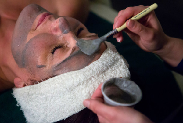 Esthetician Riki Theriault puts a charcoal cleansing mask on the face of Michelle Sherbak as part of an &quotAnthony's Classic&quot facial at Anthony John's Day Spa in Bangor on Tuesday.