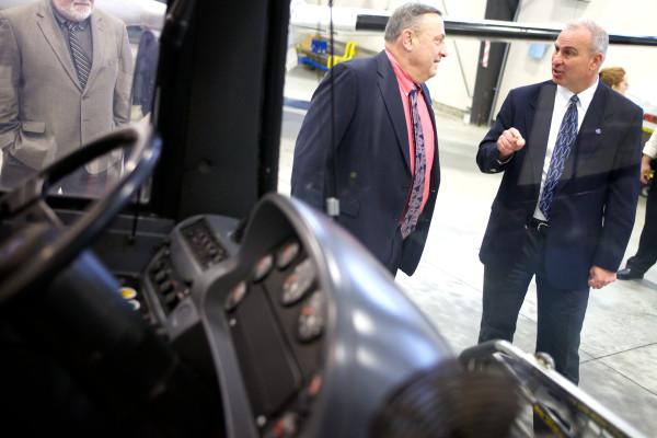 Hugh &quotTim&quot Corbett speaks to Gov. Paul LePage in a 2014 photo.