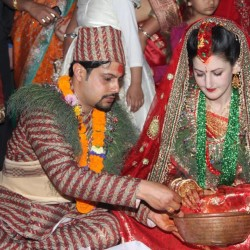 Ankit Dhakal and Ashley Hinson Dhakal are shown in their wedding finery.