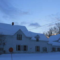 An older farmhouse-style home on Elm Steet in Presque Isle, built in 1900, has been for sale by owner for at least two years.