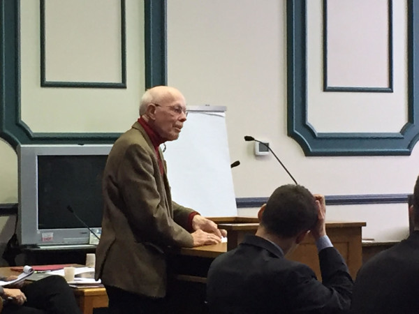 Defendant John Peck, 76, of Brunswick, who represented himself on Wednesday, questions Bath Police Lt. Robert Savary during the trial of the so-called &quotZumwalt 12&quot at Sagadahoc County Superior Court in Bath.