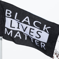 University of Maine officials and members of the Office of Multicultural Student Life raised a #BlackLivesMatter flag at the Memorial Union on Wednesday afternoon as a symbol of unity, even after acknowledging that it is a sometimes a controversial symbol of discord.