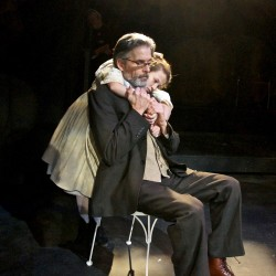 "Maiya Koloski as Iris gives Paul Haley as Simms a hug in Mad Horse Theatre Company's production of ""The Nether."" Jennifer Haley's play questions the consequences of living out dark impulses in a virtual world."