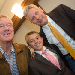 Tristan Pelletier of Bethel gets his picture taken with Libertarian presidential candidate Gary Johnson (right) and his running mate, Bill Weld, at a campaign event in Portland.
