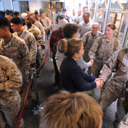 Maine Troop Greeters shake hands with Marines as they arrive at the Bangor International Airport in this March 2014 file photo. The airport will host service in Charlotte, North Carolina, from June to August.