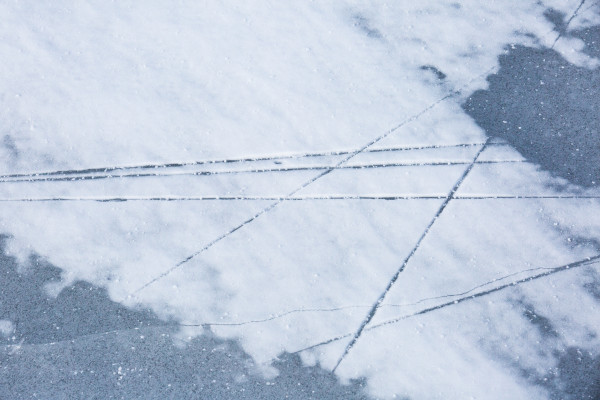 Tracks from ice boaters in the snow can be seen on Monday on Damariscotta Lake in Jefferson.