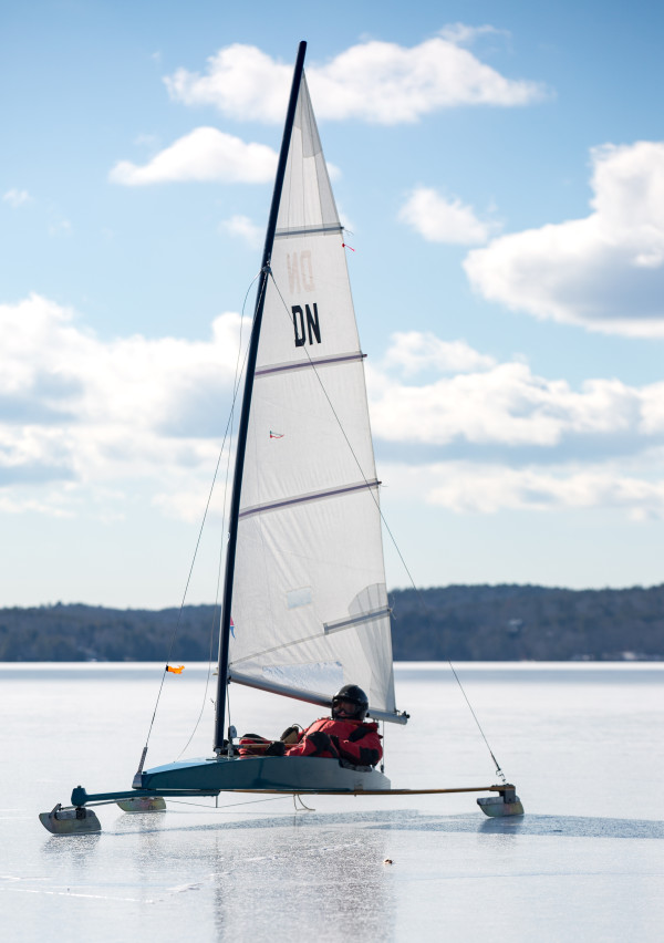 Jim Gagnon of Southport, treasurer of the Maine-based Chickawaukie Ice Boat Club, enjoys a light breeze while ice boating on Monday on Damariscotta Lake in Jefferson.