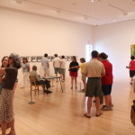 Community members check out art at the Colby College Museum of Art in this July 2013 file photo.