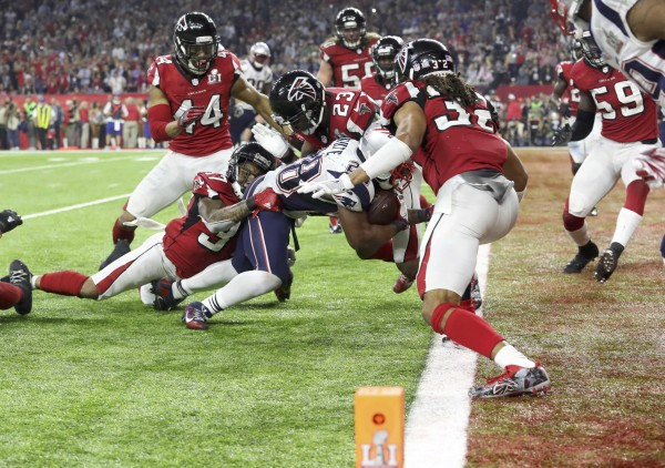 New England Patriots' James White scores a touchdown during overtime to win the Super Bowl LI against the Atlanta Falcons in Houston, Texas, on Sunday  night.