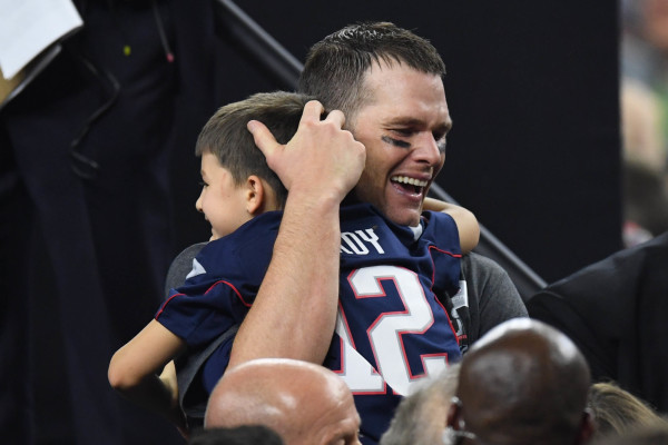 New England Patriots quarterback Tom Brady (12) greets his son after the win over Atlanta Falcons during Super Bowl LI at NRG Stadium in Houston on Sunday night.