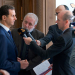 Syria's President Bashar al-Assad speaks to a group of Belgian reporters in this handout picture provided by SANA on February 7, 2017, Syria.
