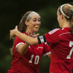 Charlotte Messer of Camden Hills High School (left), pictured during a September 2015 game in Bangor, will attend the University of Maine on a soccer scholarship starting in September.