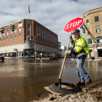 Bangor Public Works employee Dwayne, who didn't give his last name, puts up a stop sign at the main intersection of downtown Bangor on Wednesday during a brief power outage.
