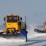 Snowplows clear the aprons at Bangor International Airport in December 2009. A computer system controlling the airfield lights at the airport is undergoing an emergency upgrade after officials determined the system was unstable.