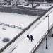 People cross the pedestrian bridge in Bangor Thursday.