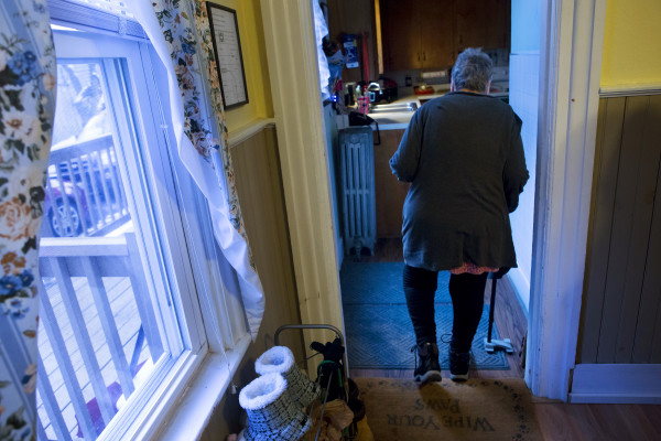 Geneva Belden walks to her kitchen at her home in Bangor on Jan. 19. Belden fell on two occasions under the watch of service provider Branches. While those injuries were not necessarily caused by abuse or neglect, the state should have investigated those cases but never did.