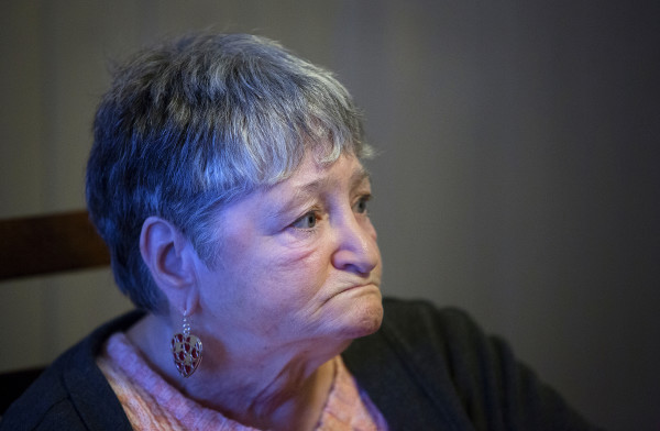 Geneva Belden sits at her dining room table at her home in Bangor on Jan. 19. Belden fell on two occasions under the watch of service provider Branches. While those injuries were not necessarily caused by abuse or neglect, the state should have investigated those cases but never did.