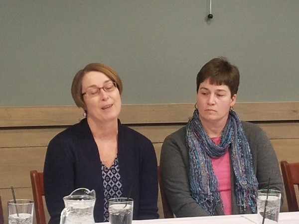 Michelle Holmes Abell (right), a kindergarten teacher in Massachusetts, and her sister, Coralie Duttweiler of Hodgdon, take part in a panel discussion on the importance of kidney donation on Friday at the Sea Dog Brewing in Bangor.