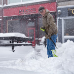 Blaze maintenance man Robert McClure tries to keep on top of the falling snow so there's a clear path to the business on Monday afternoon in Bangor.