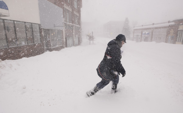 Bangor letter carrier Mike Allen delivers mail in blizzard conditions in downtown Bangor Monday.