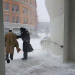 Bangor police Officer Nathaniel Alvarado (right) helps Stewart Eaton, a homeless man, down the stairs from the building at 1 Merchants Plaza in downtown Bangor on Monday. Eaton was arrested after allegedly violating the conditions of his bail after he got into the building and camped out in an elevator to stay warm and out of the storm.
