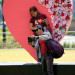 People take a selfie in front of a heart-shaped display a day before Valentine's Day in Luneta park, metro Manila, Philippines, Feb. 13, 2017.
