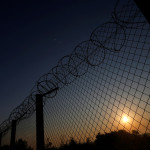 The sun rises along the Hungary and Serbia border fence near the village of Asotthalom, Hungary, Oct. 2, 2016.
