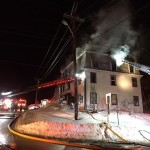Crews battled a blaze at a three-story apartment building fire at 11 Main St. Tuesday evening.
