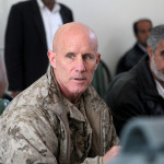 Vice Adm. Robert Harward speaks to an Afghan official during his visit to Zaranj, Afghanistan, in this handout photo from Jan. 6, 2011.