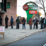 About a hundred people wait in line before the polls open at the Portland Expo on Nov. 8, 2016.