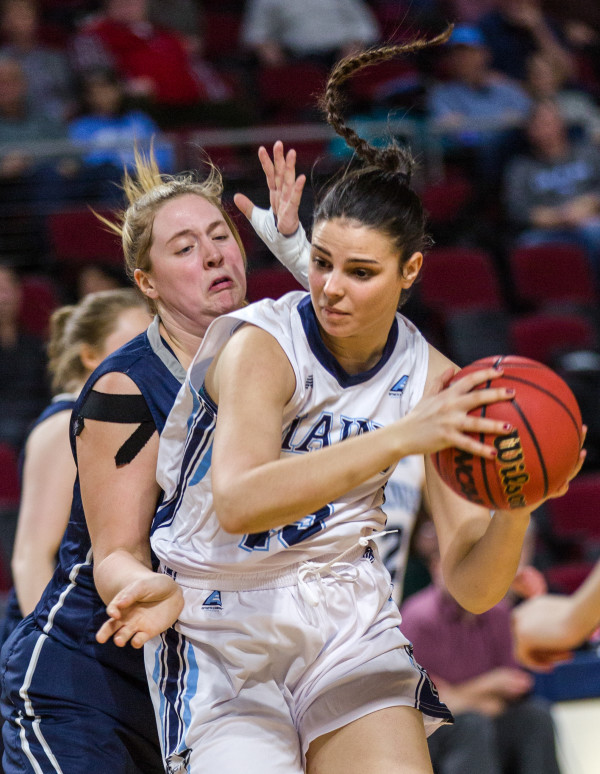 University of Maine's Laia Sole (right) looks to pass but is guarded by University of New Hampshire's Kat Fogarty during their game at the Cross Insurance Center in Bangor on Wednesday.