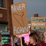 Supporters of Planned Parenthood rally outside a Planned Parenthood clinic in Detroit, Michigan, Feb. 11, 2017.