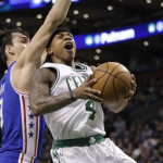 Isaiah Thomas (4) of Boston drives to the basket against Philadelphia's Dario Saric (9) in the second half of Wednesday night's game at TD Garden in Boston. The Celtics defeated the 76ers 116-108.