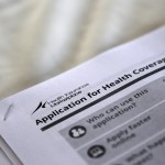"The federal government forms for applying for health coverage are seen at a rally held by supporters of the Affordable Care Act, widely referred to as ""Obamacare"", outside the Jackson-Hinds Comprehensive Health Center in Jackson, Mississippi, on Oct. 4, 2013."