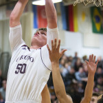Orono's Keenan Collett (left) goes up for a layup past Hermon's Keenan Marseille during their basketball game in Orono in January. Orono and Hermon are likely to be two of the top contenders in the Class B North tourney.