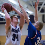 Hampden Academy's Ian McIntyre (left) looks to go up for a basket against Messalonskee's Cole Wood during their game in Hampden in December. Both Hampden and Messalonskee are expected to be in the thick of the race for a Class A North title.