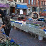 A customer shops for fresh produce at the Portland Farmers' Market in this November 2013 file photo.