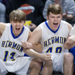 Michael Berube (left) and Dylan Leighton of Hermon High School celebrate as their team takes the lead against Washington Academy during their Class B boys basketball quarterfinal game at the Cross Insurance Center in Bangor on Saturday. Ashley L. Conti | BDN
