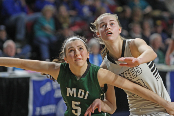 Houlton's Kolleen Bouchard (right) and Mount Desert Island's Julia Watras jostle for rebounding position during Saturday's Class B North basketball quarterfinal in Bangor. Houlton won 47-39.  