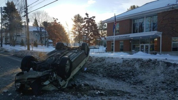 A driver who reportedly fell asleep at the wheel struck a snowbank and took out a telephone pole before rolling over in front of the Brunswick Police Department.