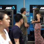 Australia and New Zealand Banking Group Ltd customers use their ATMs at a branch in Sydney, Feb. 16, 2016.
