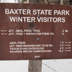 A sign marks the intersection of the Appalachian Trail and the Abol Pond Trail at Baxter State Park.